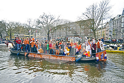 AMSTERDAM - APRIL 30: Amsterdam canals full of boats and people Editorial Image