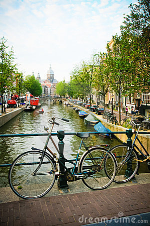 Amsterdam Bicycles and Canal Editorial Stock Photo