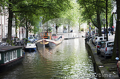 Amsterdam canal with houseboats Editorial Stock Photo