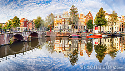 Amsterdam Canal houses vibrant reflections, Netherlands, panora Stock Photo