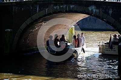 The Amsterdam canal under the bridge Editorial Stock Image