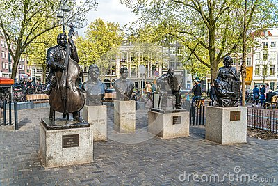 Five statues of famous singers on the Elandsgracht in the Jordaan in Amsterdam Editorial Stock Photo