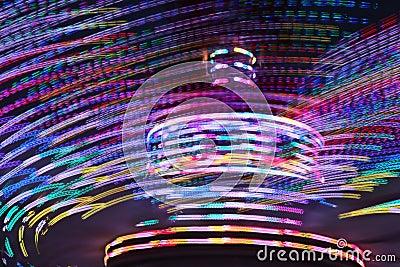 Amusement park spinning lights