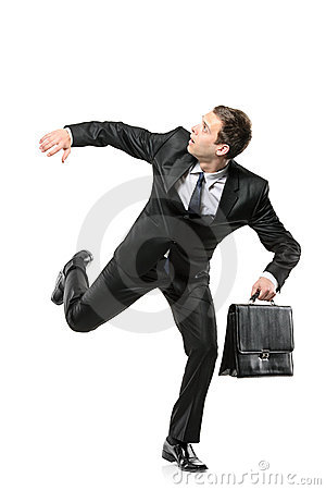 Free An Afraid Businessman Running Away Stock Image - 13878731