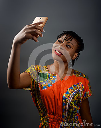 Free An African Lady Taking A Selfie Stock Photo - 91926500