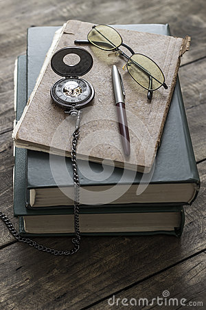 Free An Antique Pocket Watch, Glasses And Books Royalty Free Stock Photo - 49826775