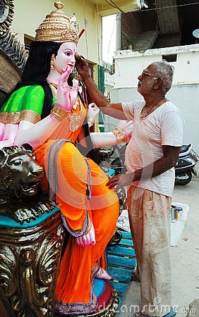 Free An Artist Painted On A Sculpture Of Goddess Durga. Indian Festival. Royalty Free Stock Photos - 131355568