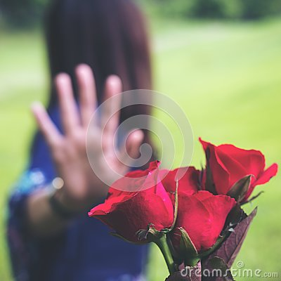 Free An Asian Women Rejecting A Red Rose Flower From Her Boyfriend On Valentine`s Day With Nature Royalty Free Stock Images - 103781989