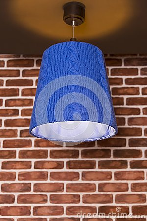 Free An Original Knitted Lamp Hanging On A Wall Against Royalty Free Stock Image - 108111886