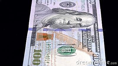 Analyse de la devise Faible profondeur de champ USD 100 front banque de vidéos