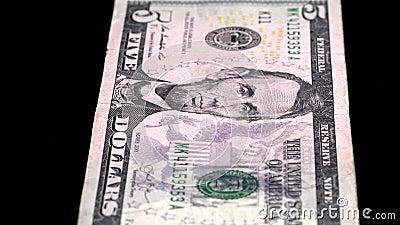 Analyse de la devise faible profondeur du champ USD 5 avant banque de vidéos