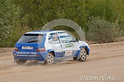 Anatoliy Kosarev drives a blue Citroen car during Editorial Stock Photo