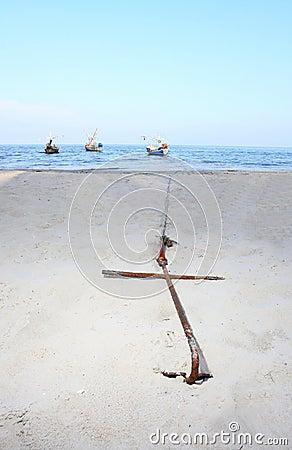 Anchor buried on the beach f