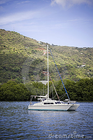 Free Anchored Catamaran Stock Images - 12045654
