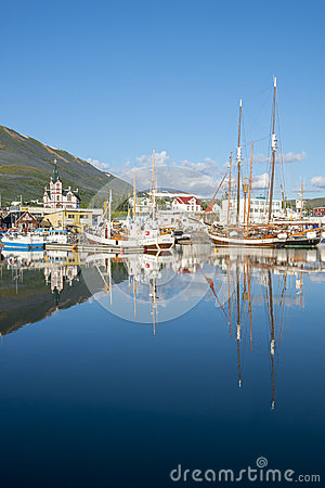 Free Anchored Fishing Boat In Husavik Harbor In Husavik, Iceland. Royalty Free Stock Photography - 42675157