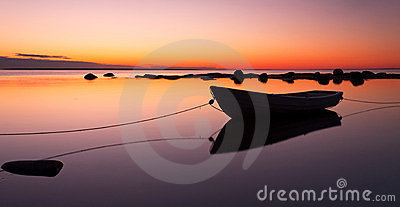 Anchored rowing boat at sunset