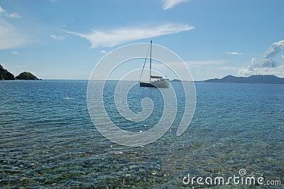 Anchored sailboat