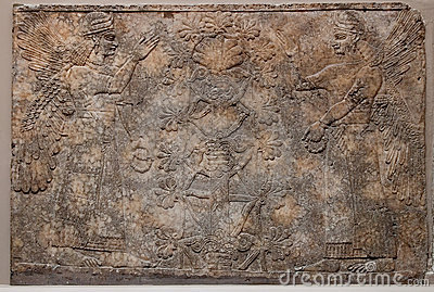 Ancient assyrian relief depicting winged gods or s