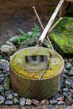 Ancient Bamboo and stone fountain