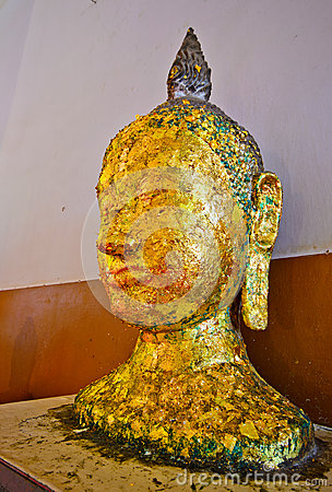 Ancient Buddha face Image, in Ancient temple,TH.