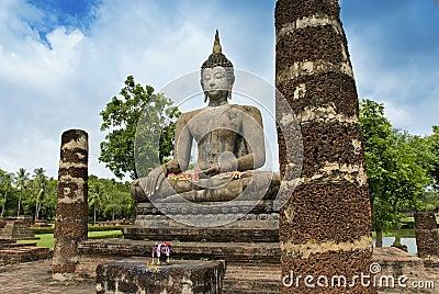 Ancient Buddha among the ruins