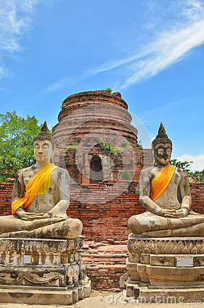 Ancient buddha statues with blue sky