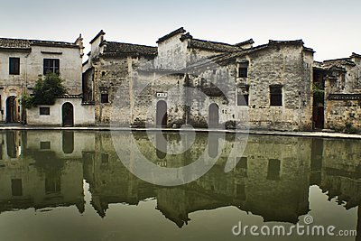 Ancient chinese buildings reflected on water
