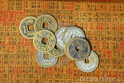 Ancient Chinese coins on a text back