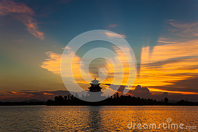 ancient chinese pavilion under sunset