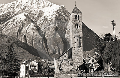 Ancient church with Alps