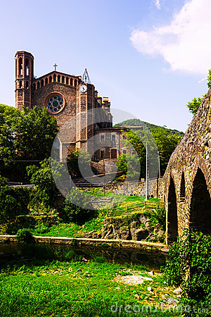 Ancient church and medieval bridge in Sant Joan les Fonts