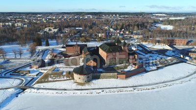 Ancient fortress on the background of the urban landscape aerial. Hameenlinna. Ancient fortress-prison on the background of the urban landscape, March Sunny stock video footage