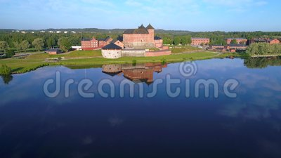 The ancient fortress city of Hameenlinna and lake Vanajavesi, July afternoon. Finland. The ancient fortress city of Hameenlinna and lake Vanajavesi. July stock video footage