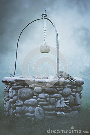 Ancient fountain in the fog Stock Photo