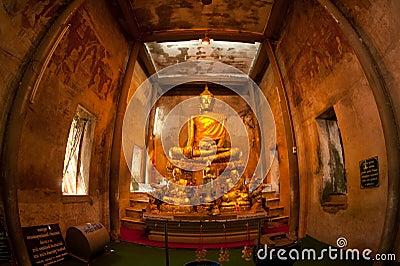 Ancient golden buddha in Thai church.