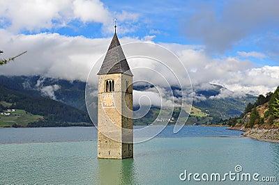 Ancient half-submerged bell tower in Graun im Vinschgau Editorial Image