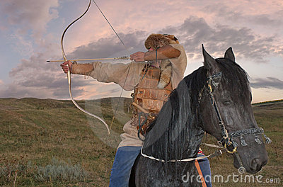 Ancient horseman weaponed with arc