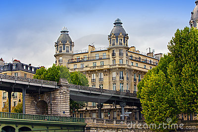 The ancient house behind the bridge in Paris