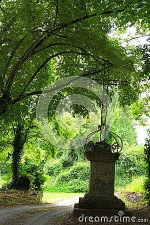 Ancient iron cross, cemetery entrance