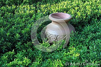 Ancient jar in grassland,horizontal precise compos