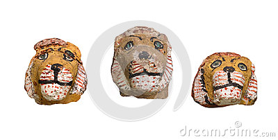 Ancient lion head figures isolated.