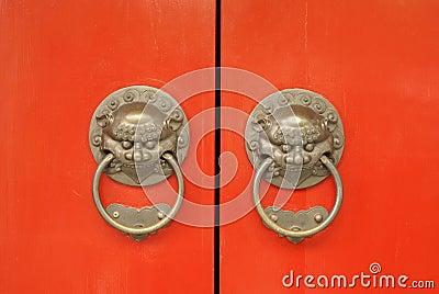 Ancient oriental red temple door