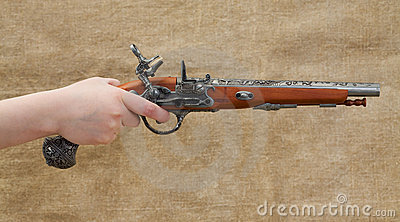 Ancient pistol in female hand