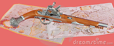Ancient pistol on maps background