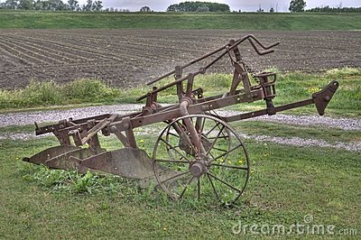Ancient plough on the grass