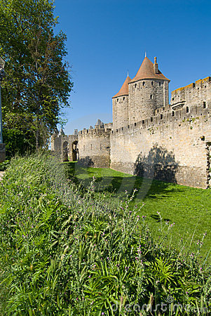 Ancient rampart and tower of Carcassonne chat