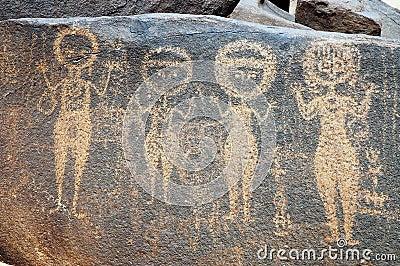 Ancient rock art in Niger depicting four figures