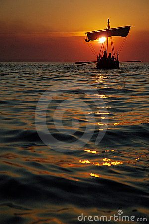 Ancient Sailboat at Sunset