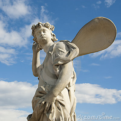 Ancient sculpture angel in the blue sky.