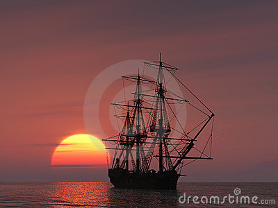 Ancient ship at sunset
